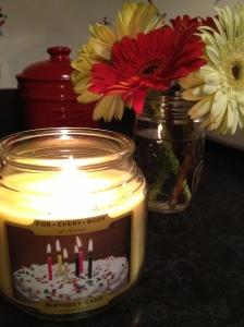 Burning my birthday cake candle while baking our birthday cake!