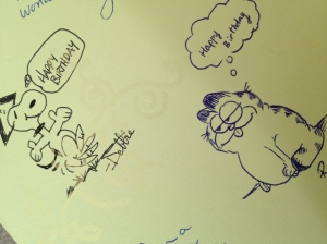 A couple of doodles from my co-workers inside a birthday card.